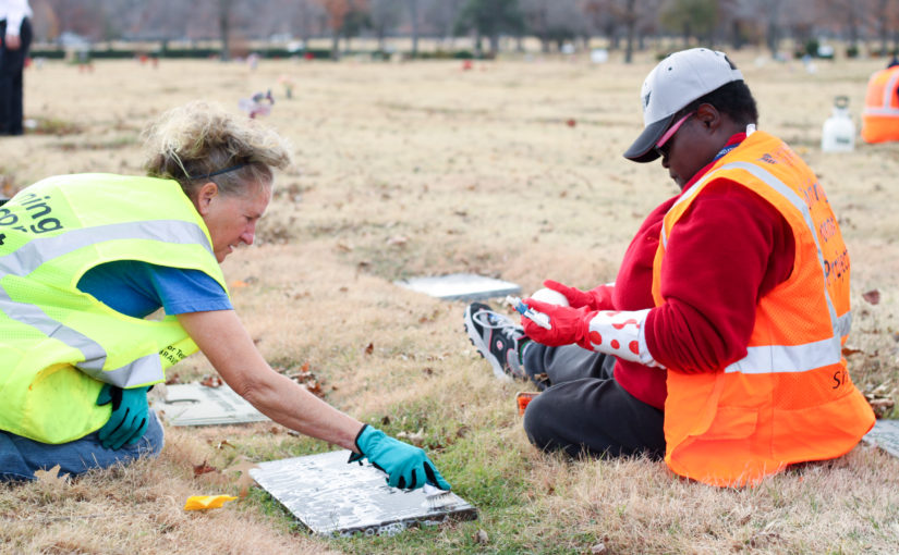 Cleaning a veteran headstone at Memorial Park Cemetery in Tulsa Oklahoma