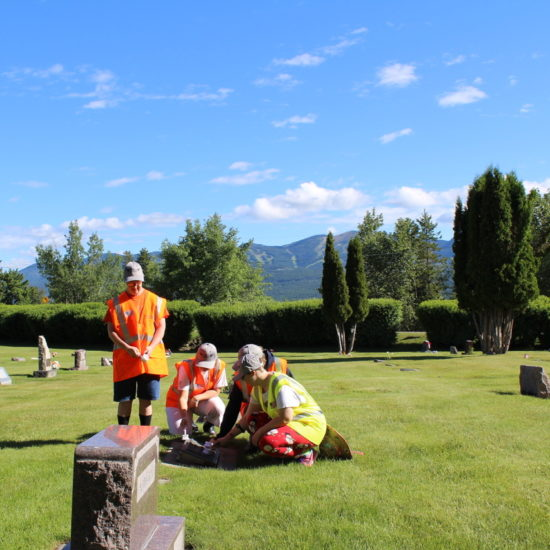 Honor Team members cleaning a veterans headstone in Montana for the Shining Honor Project